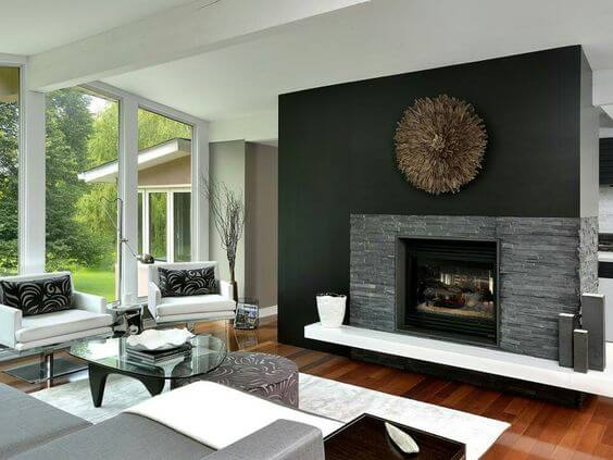 dark stone veneer and a black wall fireplace