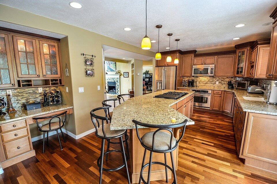 kitchen island with cooking and eating area