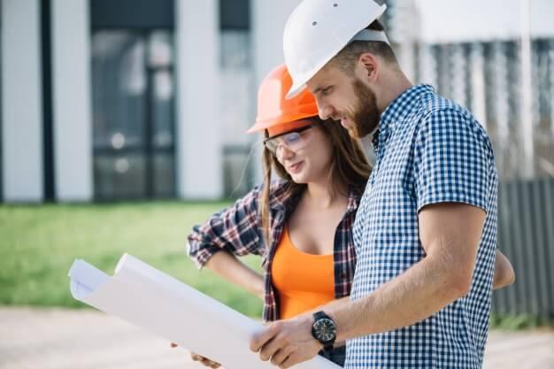 contractor showing blueprints