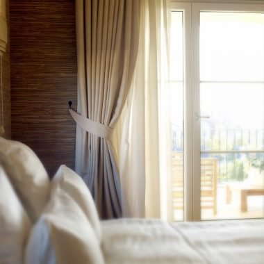 Sunny bedroom with elegant curtains